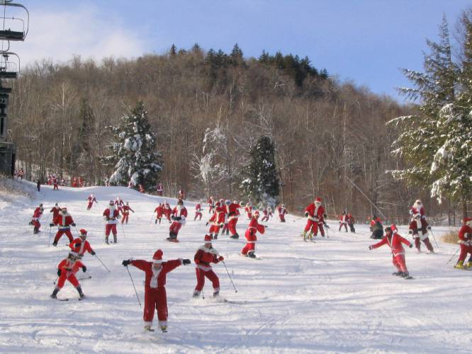 If one Santa skiing doesn't make you smile, how about 250? That's what you get on Santa Sunday at Sunday River in Maine.